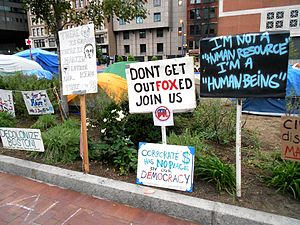 English: Protest signs outside of Occupy Boston.