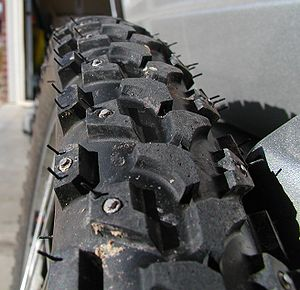 Studded mountain bike tires for use in icy con...
