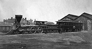 United States Military Railroad 4-4-0 locomotive W.H. Whiton (built by William Mason in 1862) in January 1865 with Abraham Lincoln's presidential car, which later was used as his funeral car.