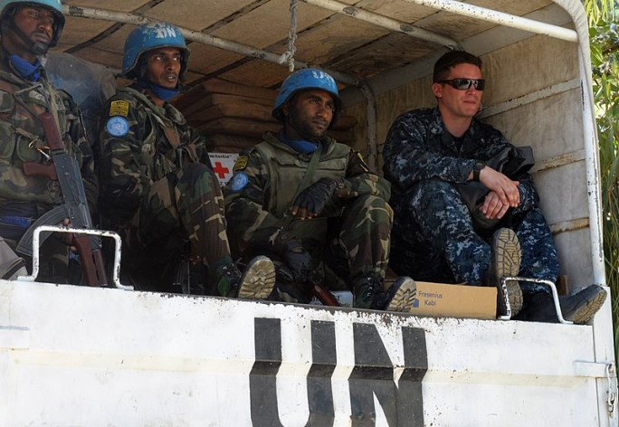 File:US Navy 100128-N-1831S-024 ogistics Specialist 3rd class Jerdone McGhee sits in the back of a U.N. truck with U.N. Soldiers as they prepare to drop off supplies at the Operation Hope for Children of Haiti clinic in Killick.jpg