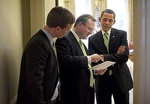 President Barack Obama talks with White House ...