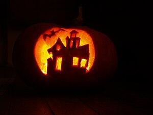 English: Pumpkin carving - photo taken in dark...