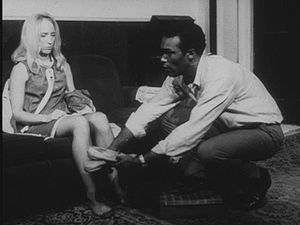 Actor Duane Jones as Ben gives actress Judith ...