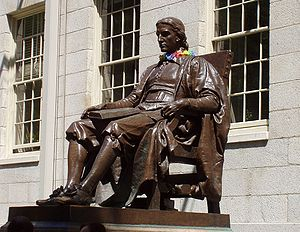 Statue of John Harvard, founder of Harvard Uni...