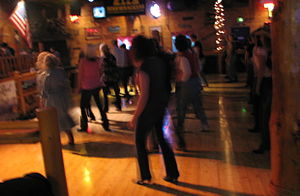 English: Line dancing at a Country Western Dan...