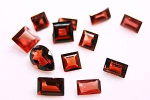 English: Collection of loose cut Garnet gemstones.