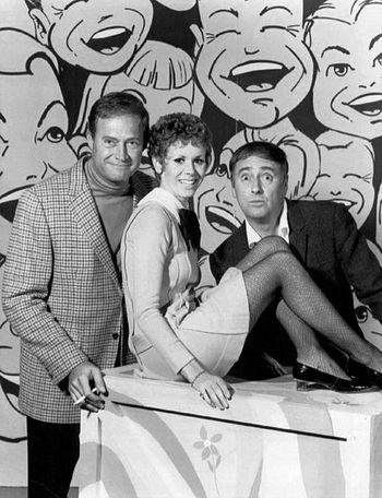 Publicity photo of Dan Rowan, Dick Martin, and...