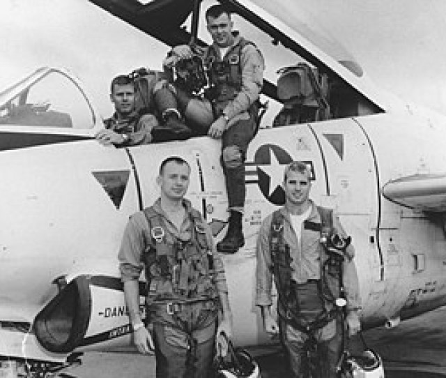 Four Military Pilots Posed In On Or In Front Of Silver Jet With