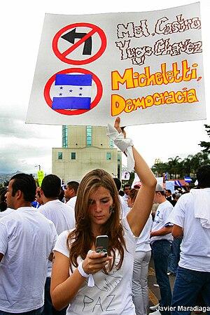 The sign opposes Manuel Zelaya, Fidel Castro, ...