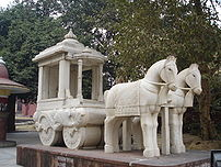 A sculpture of a Hindu horsecart in Delhi, India.