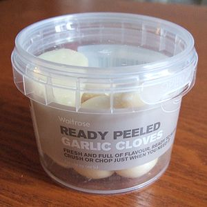 English: Waitrose ready peeled garlic in a pla...