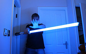 A Force FX Lightsaber photograph taken in low ...