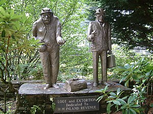 English: Loot and Extortion. Statues at Trago ...