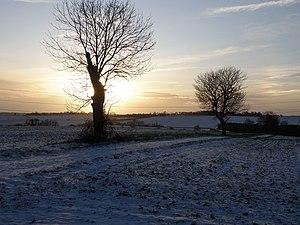 English: Low winter sun towards Steeple Gidding
