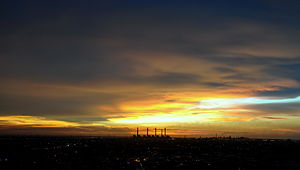 English: The setting sun in the western sky Lo...