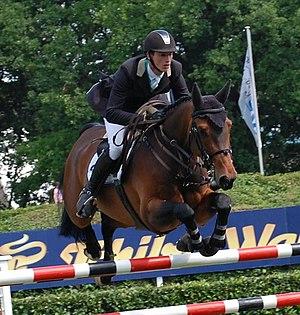 English: German rider Daniel Deußer with Cabre...