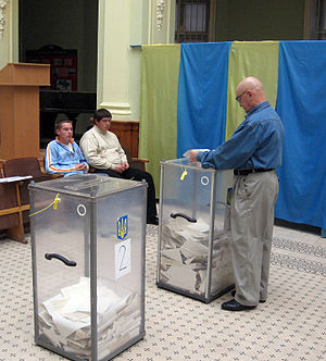 Senior voter and voting boxes