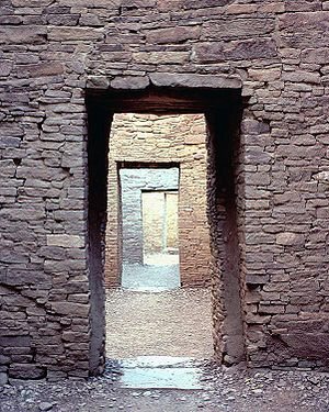 An image of the ruins of Pueblo Bonito in Chac...