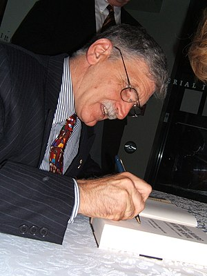 Dallaire signing copies of his book Shake Hand...