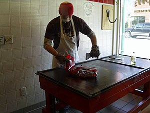 Man making red hot candy drops at Schimpff's C...