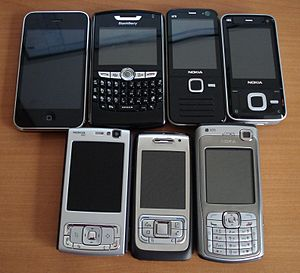 Assorted smartphones. From left to right, top ...