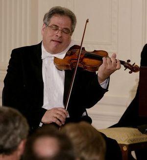 Itzhak Perlman, a polio survivor, plays the vi...