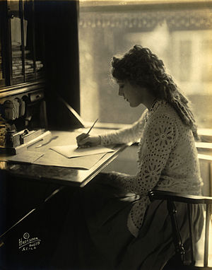 Mary Pickford writing at a desk