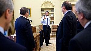 President Obama confers with senior advisors i...