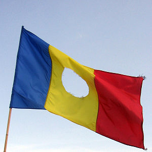Romanian flag with a hole in the center, as us...