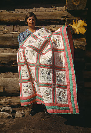 Mrs. Bill Stagg with state quilt, Pie Town, Ne...