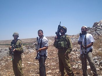 IDF soldiers and Israeli settlers