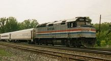 (Amtrak 345, an EMD F40PH pulls a passenger tr...