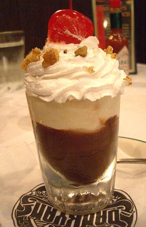 A chocolate sundae served in a shot glass