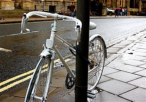 This white bike was chained to a post in Oxfor...