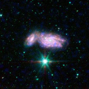 Polski: Zderzające się galaktyki NGC 935 i IC ...