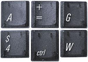 Six keys detached from a PowerBook G4 keyboard...