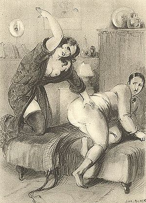 English: A woman spanking a submissive man.