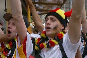 German soccer fans in Aachen cheering after Ge...