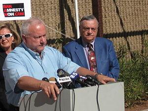 Maricopa County Sheriff Joe Arpaio, standing i...