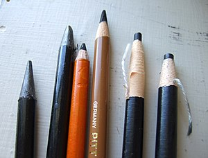 2 woodless graphite pencils in plastic sheaths...