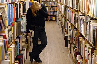 Photo of a person browsing library shelves