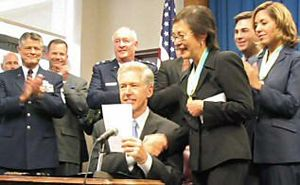 Davis signs AB 574 on September 11, 2003.