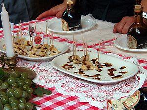 English: Balsamic vinegar drizzled over chunks...