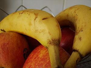 Basket of bananas and apples.