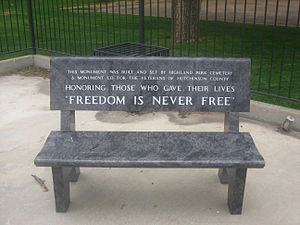 "A park bench with inscription ""Freedom Is..."