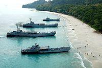 L-32, L-34, L-21, L-22 LSTs and LCUs beached.jpg