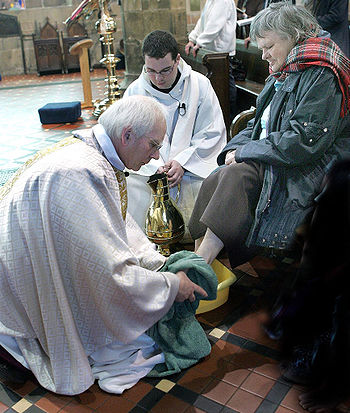 Bishop John washes the feet of Eleanor, who wa...