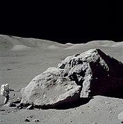 Schmitt stands next to a large boulder during EVA 3