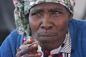 English: Nama Woman in Kalahari Desert, Namibi...