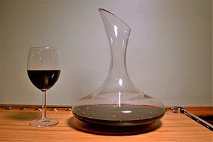 A decanter with a red wine glass